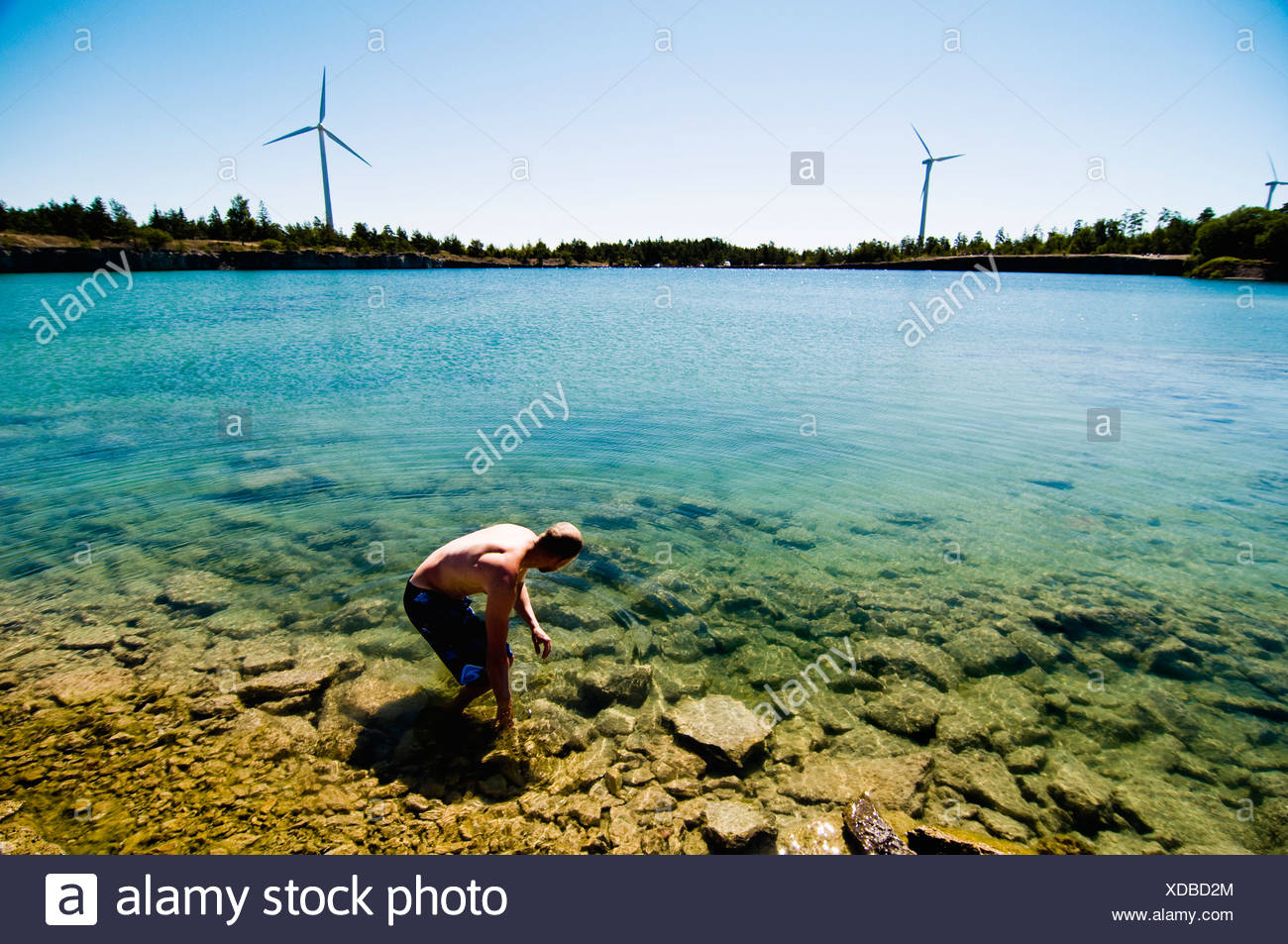 Man walking in the water Stock Photo