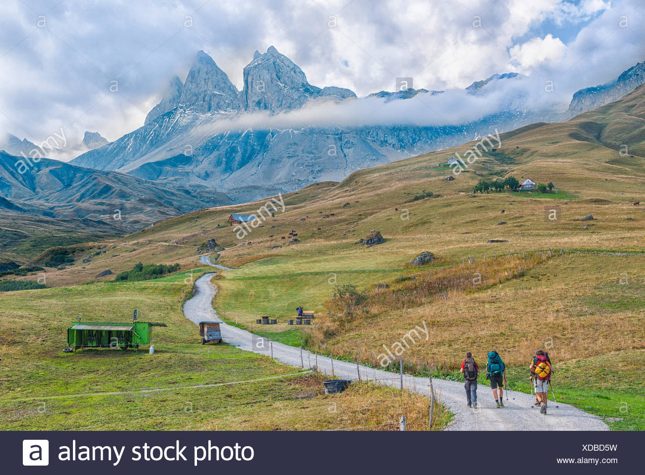 Hikers in front of the Aiguille d'Arves, Ecrins, Savoie, France - Stock Image