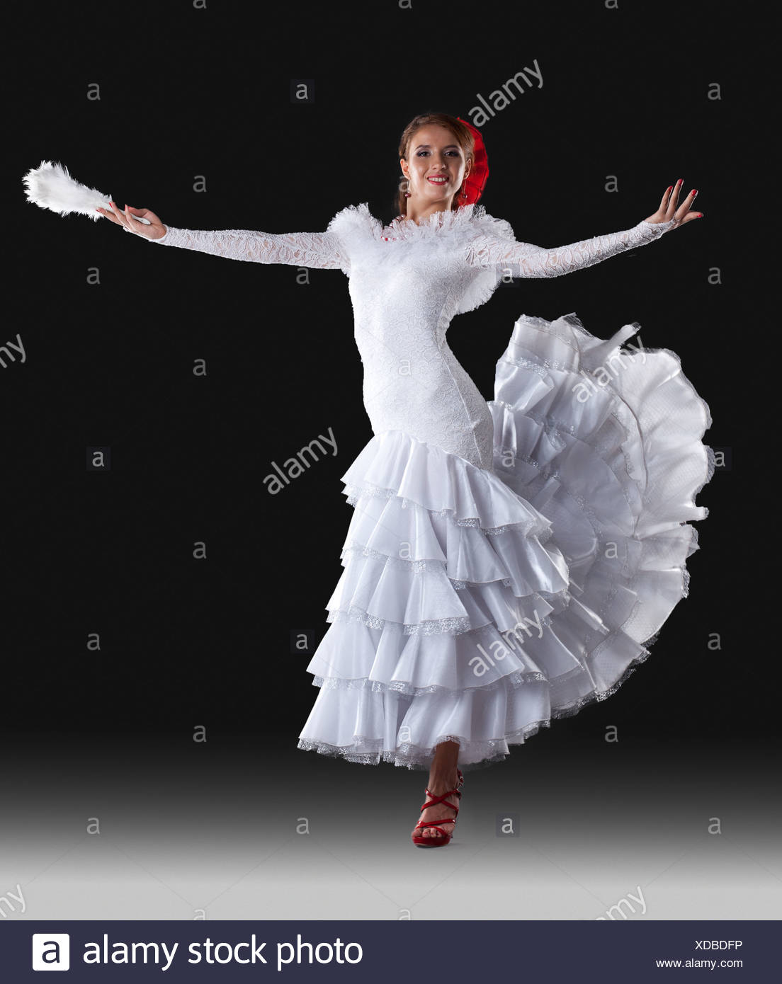 Young woman show white flamenco costume - Stock Image