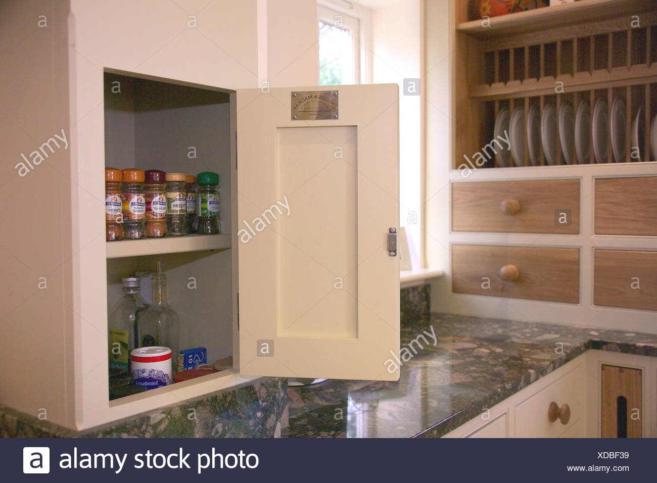 Image of: Kitchen Cupboard With Door Open On Spice Jars Stored On Shelves Stock Photo Alamy