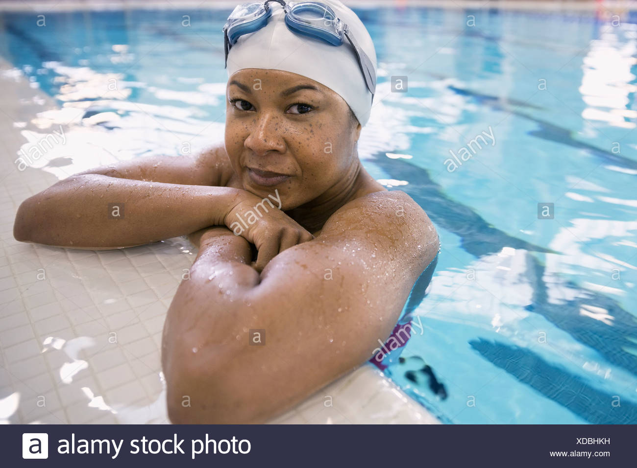 Close up portrait of woman in swimming pool - Stock Image