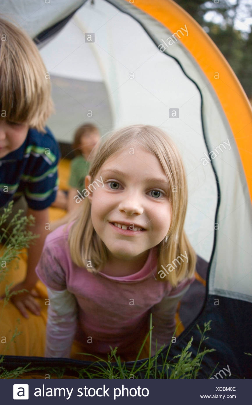 Portrait of a young girl in a tent Stock Photo