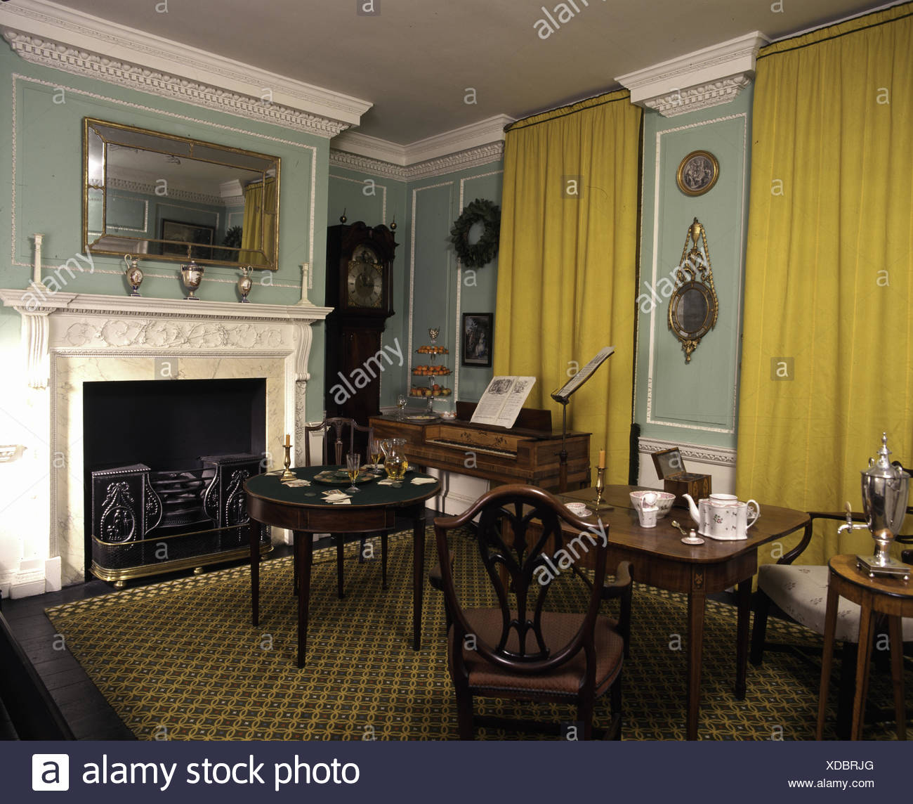 Regency dining room with antique  furniture - Stock Image