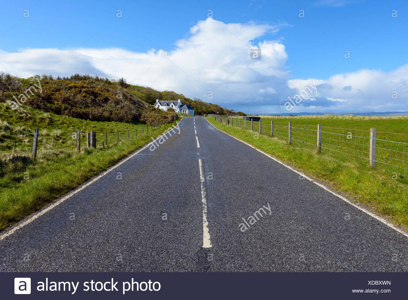 Coastal road after rainstorm, Mallaig, Scotland, United Kingdom - Stock Image