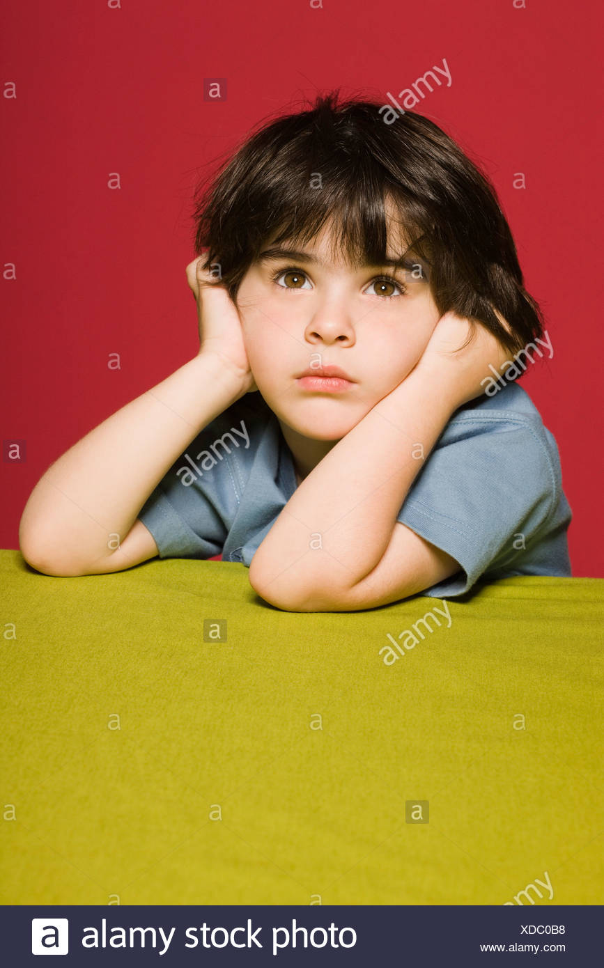Little boy daydreaming, portrait Stock Photo