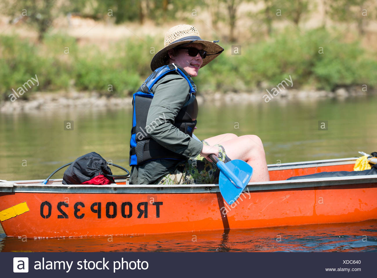 A Boy Scout paddles his canoe down the Clearwater River near Orofino, Idaho while traveling on the original Lewis and Clark Trail and canoe route. - Stock Image