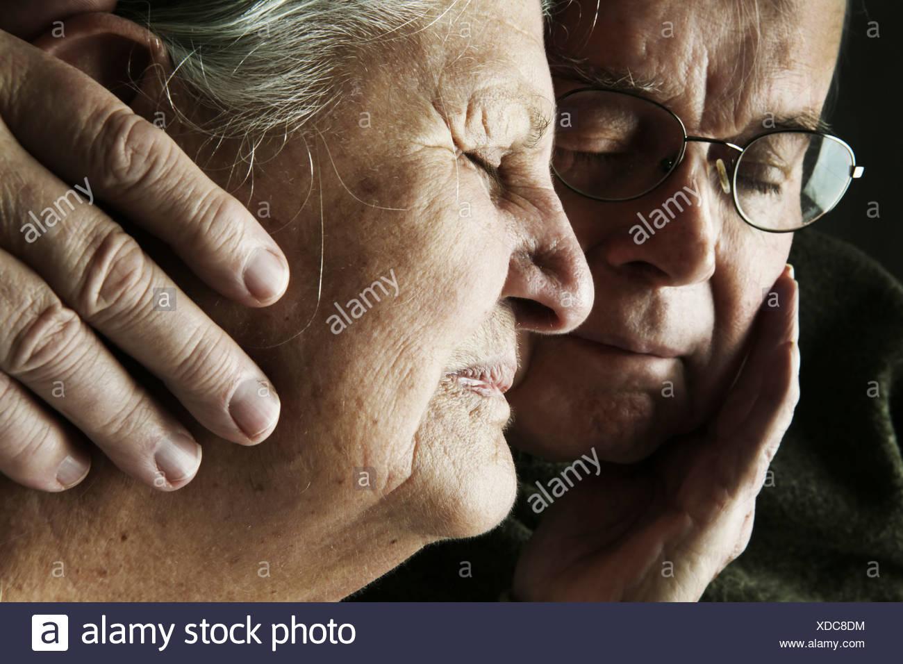 Portrait of senior couple with close eyes, close-up - Stock Image