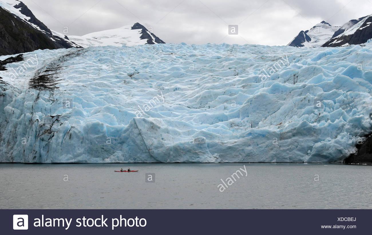 Red canoe close to Portage glacier, Alaska,USA Stock Photo