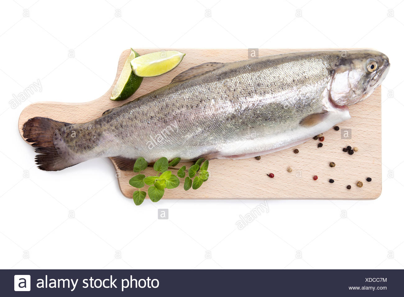 Fresh trout on wooden kitchen board. - Stock Image
