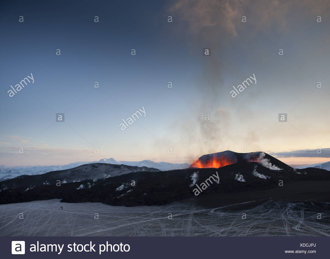 Fire and Ice-volcano eruption in Iceland at Fimmvorduhals, a ridge between Eyjafjallajokull glacier and Myrdalsjokull Glacier. - Stock Image