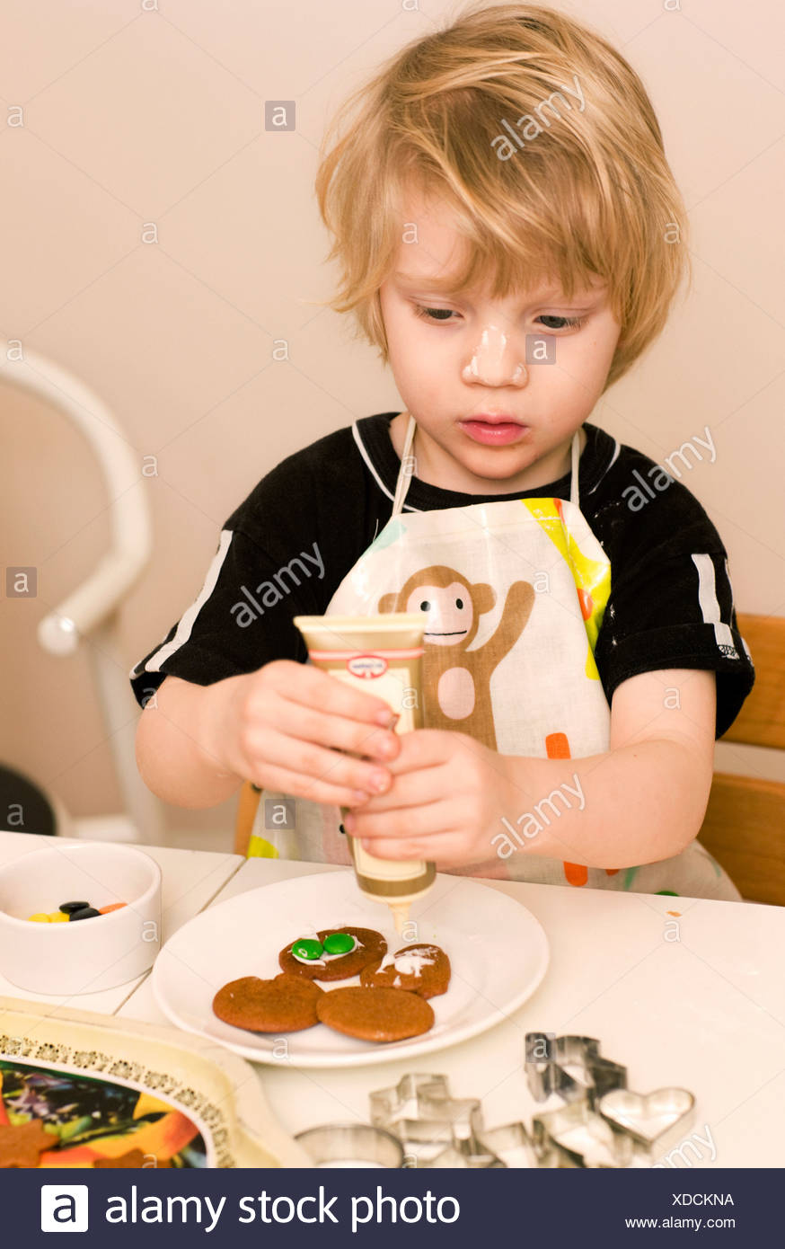 Boy preparing cookies - Stock Image