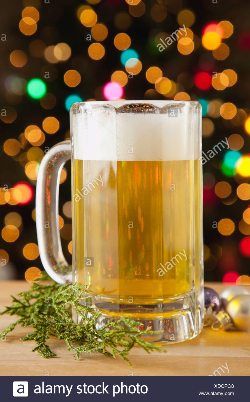 USA, Illinois, Metamora, Beer with Christmas lights in background - Stock Image