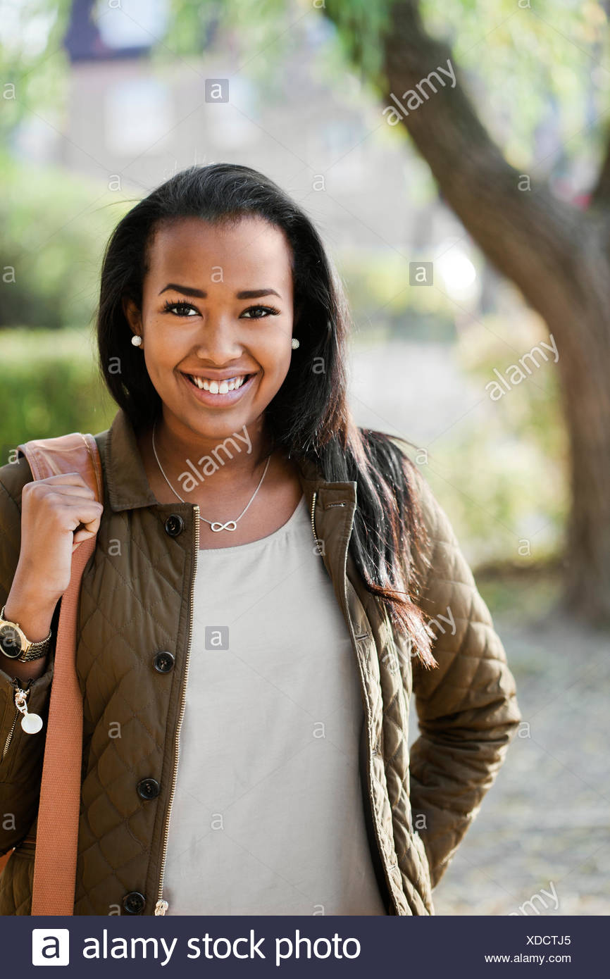Sweden, Sodermanland, Strangnas, Portrait of teenage girl (16-17) in park - Stock Image