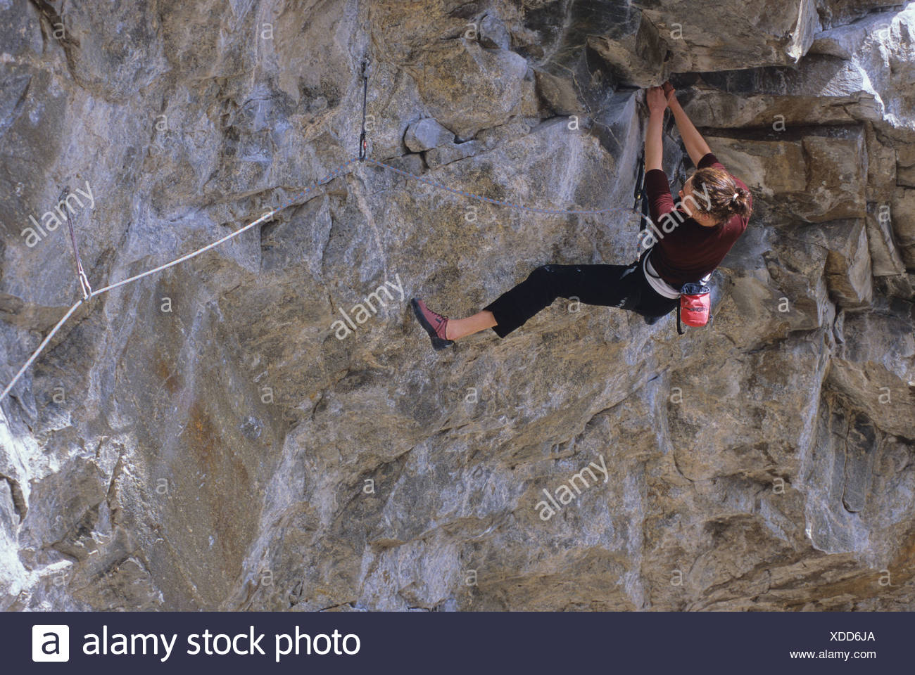 Woman climbing Not Fade Away 5.12a The Wave Wall Skaha Bluffs Penticton, British Columbia, Canada. - Stock Image