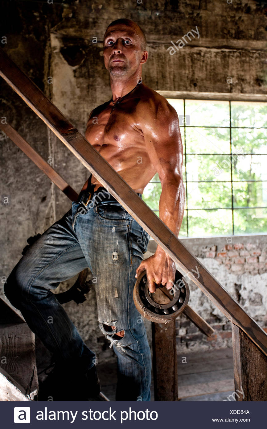 concepts,body cult,hard,guy,sweat,man,strength,muscles,workers,stair,ball bearing - Stock Image