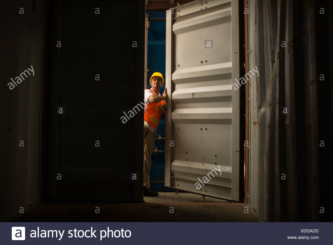 Cargo Door Stock Photos Images Alamy Electronic Filters Eg1003 Mid Adult Man Standing At The Of A Container Image