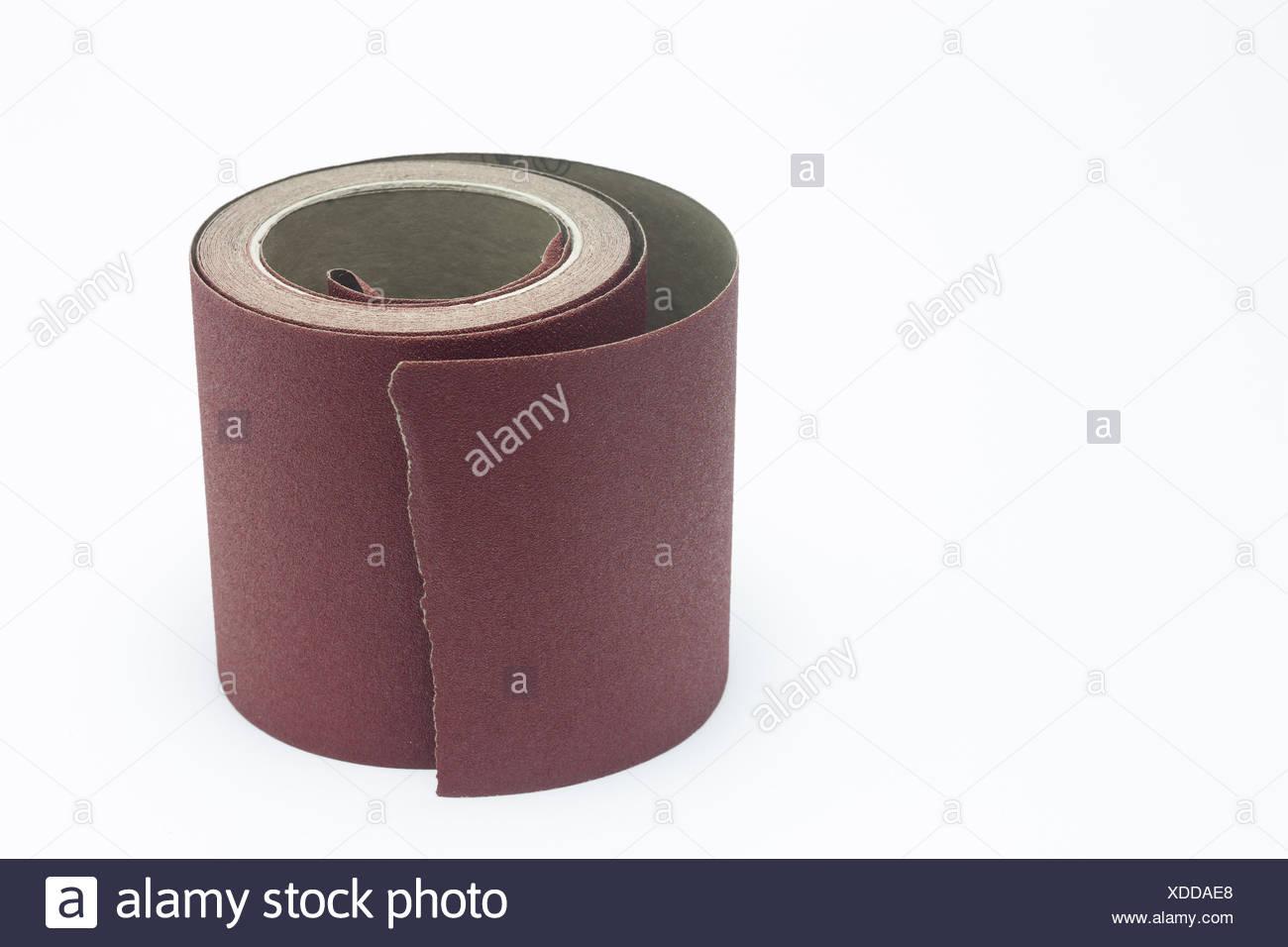 Abrasive paper tape in roll - Stock Image