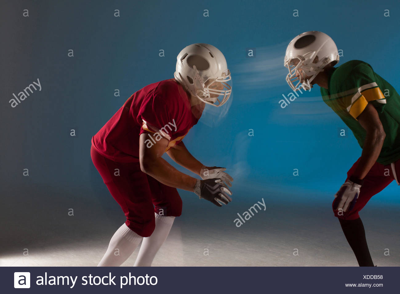 Blurred view of football players facing each other - Stock Image