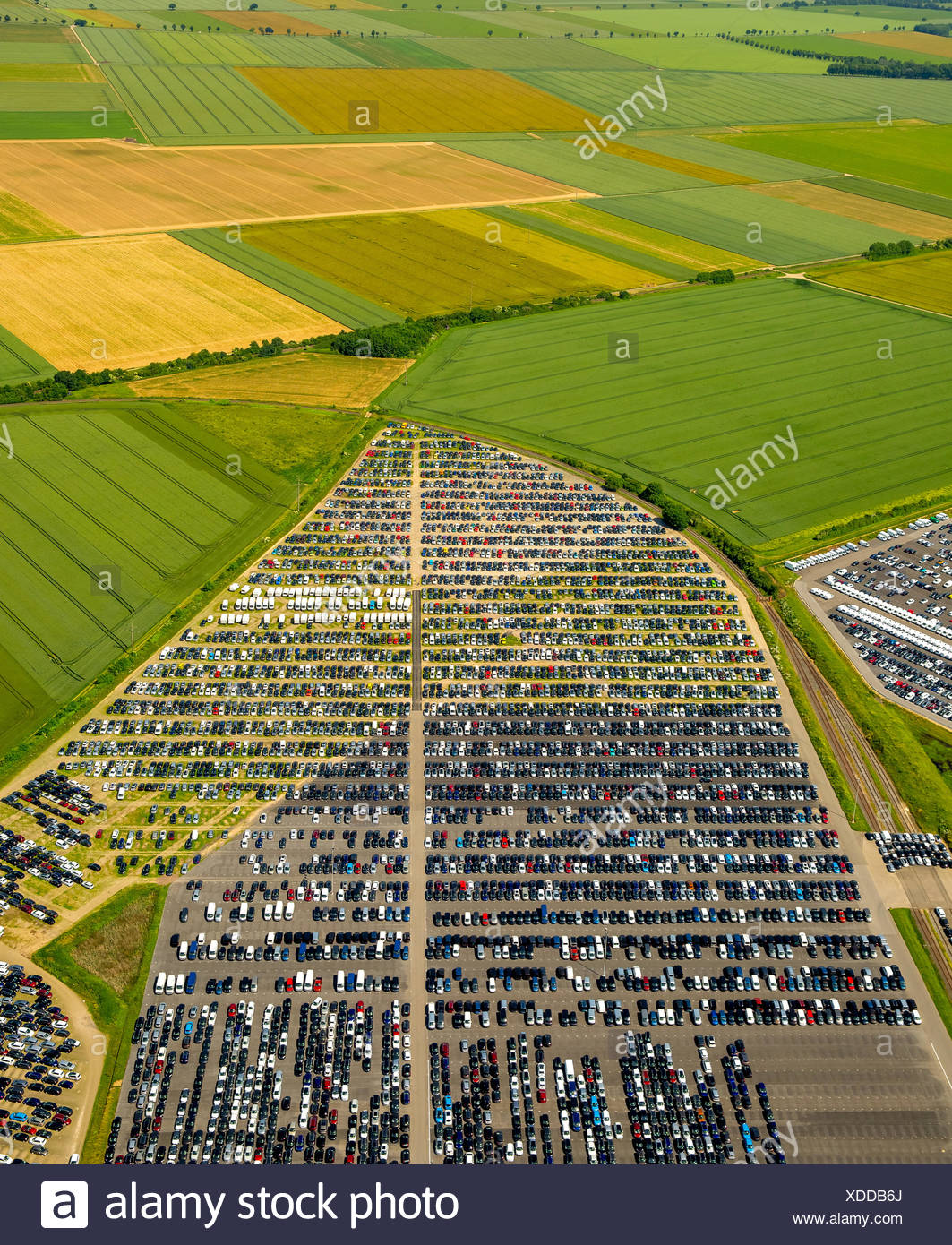 Aerial photograph, new car parking lot surrounded by fields, Citroen, Peugeot, Ford, Wallenius Wilhelmsen Logistics, Zülpich - Stock Image