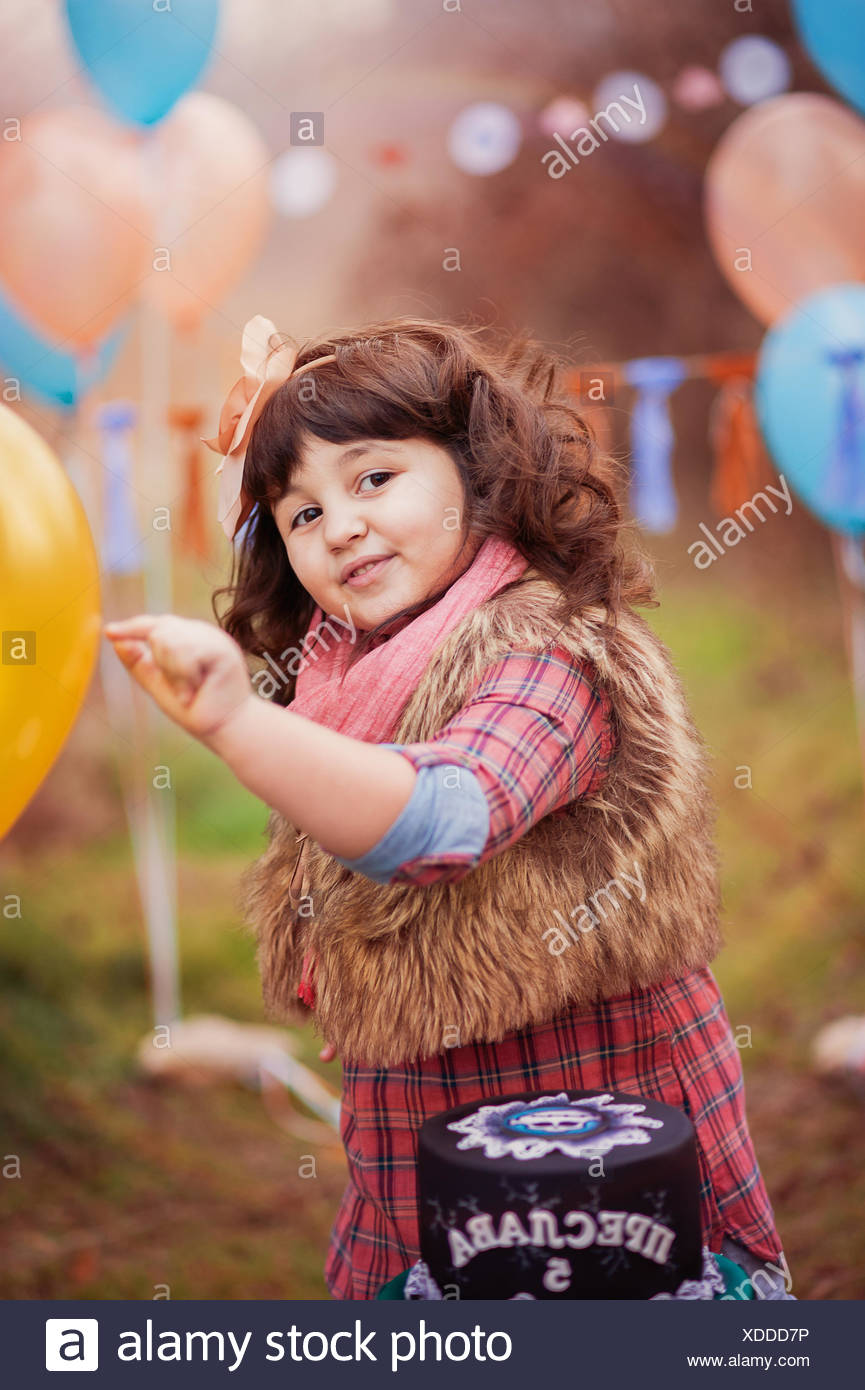 Portrait of girl (4-5) at birthday party - Stock Image
