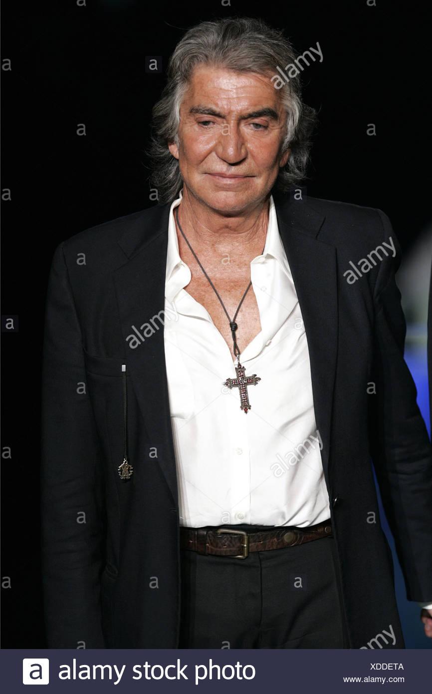 Roberto Cavalli Milan Ready To Wear S S Fashion Designer Roberto Cavalli Wearing Large Silver Cross On Leather Thread White Stock Photo Alamy