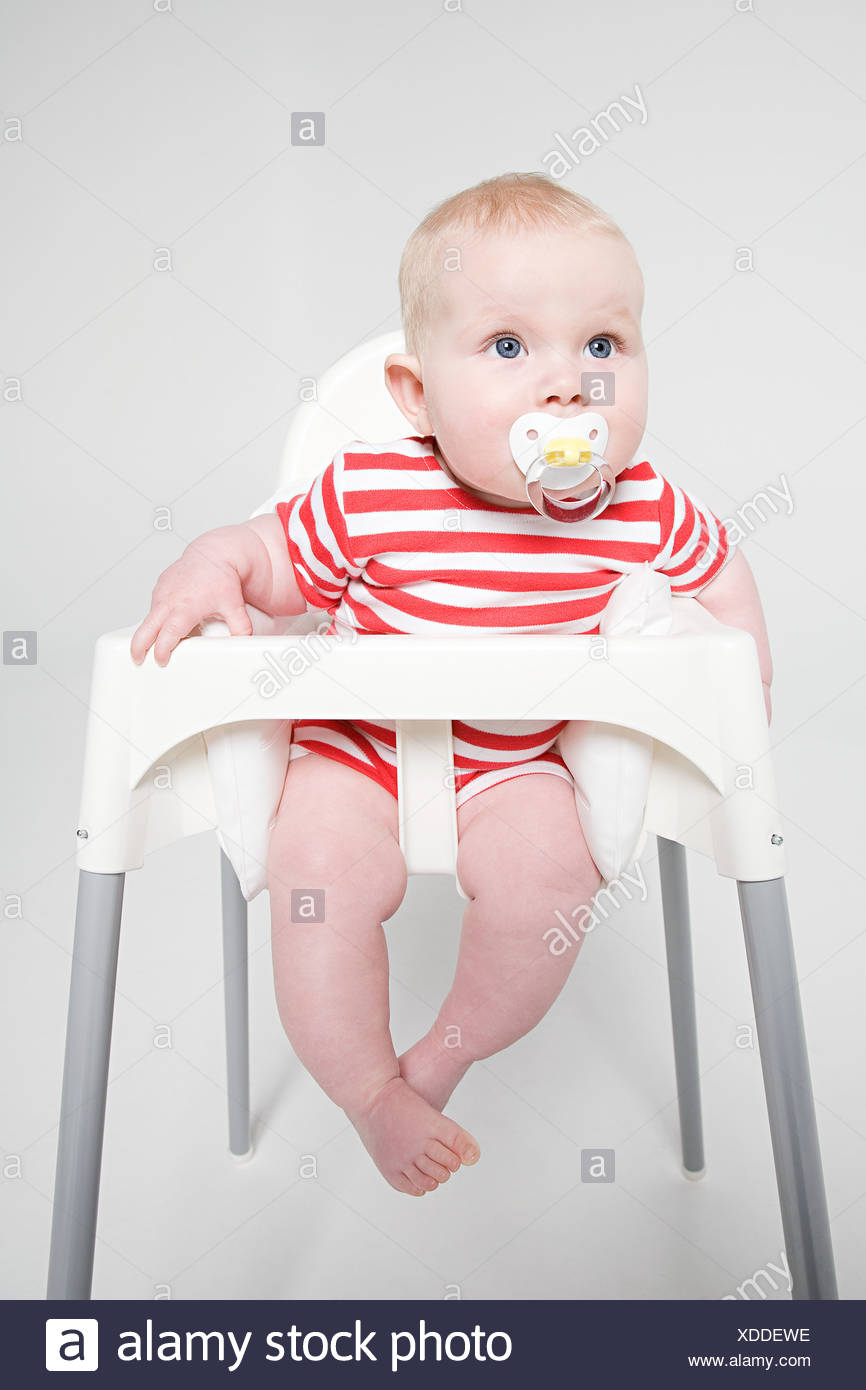 A Baby Girl Sat In A High Chair Stock Photo: 283653482   Alamy
