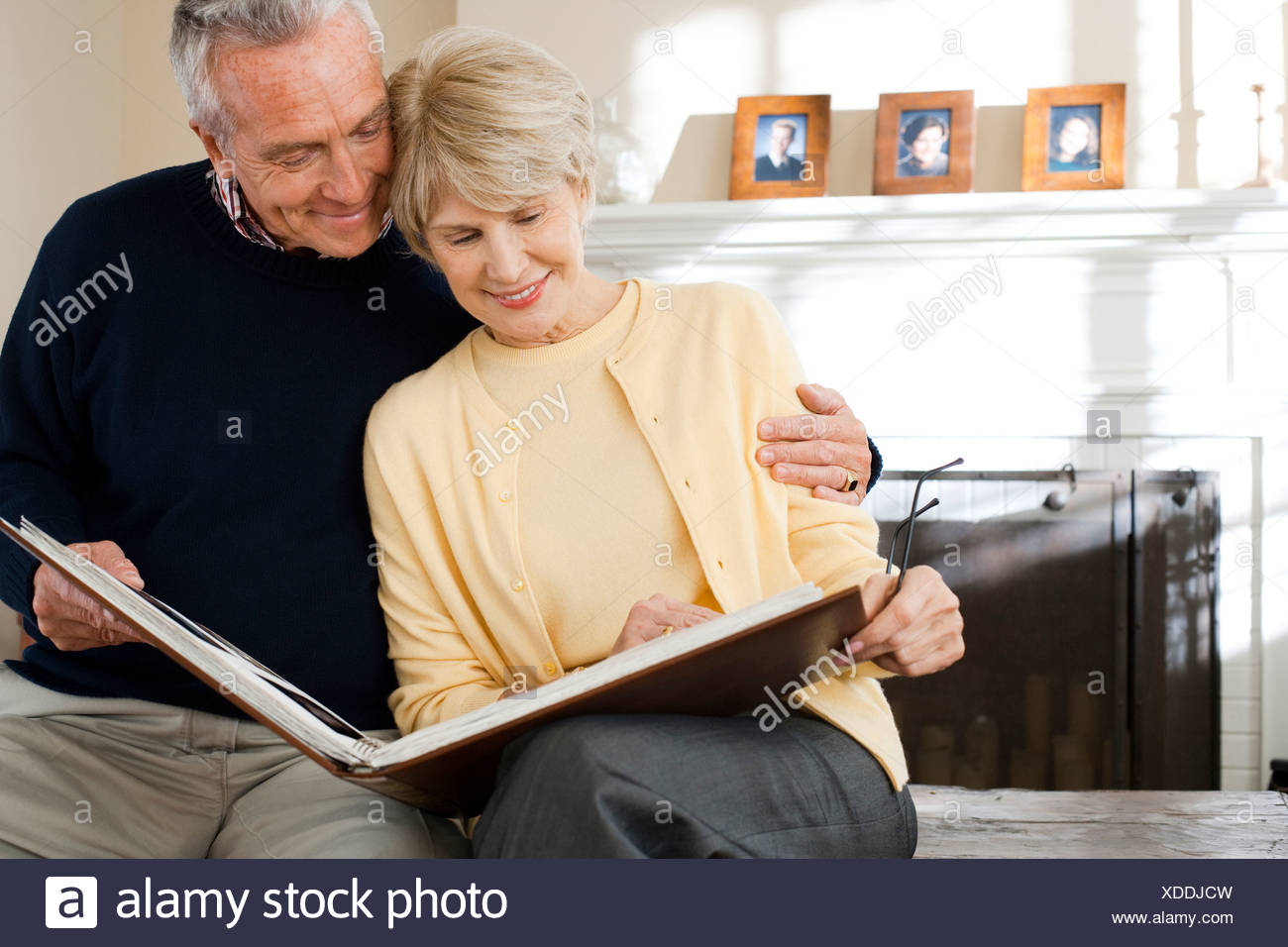 Mature couple looking at photo album - Stock Image