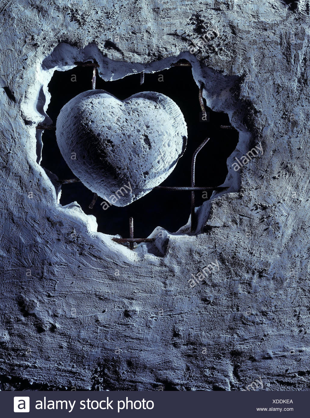 Stone defensive wall, detail, bars, heart, trapped, [M], 'heart from stone', cold-hearted, heartlessly, indifferently, insensitivity - Stock Image