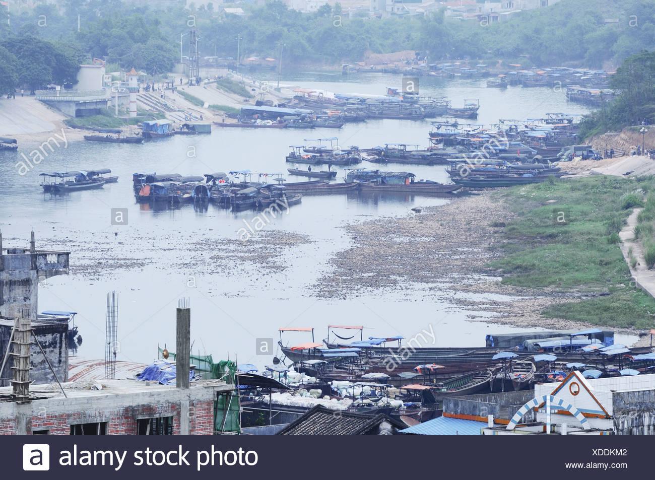 Barge on Ka Long River, Mong Cai, Quang Ninh , Vietnam Stock Photo