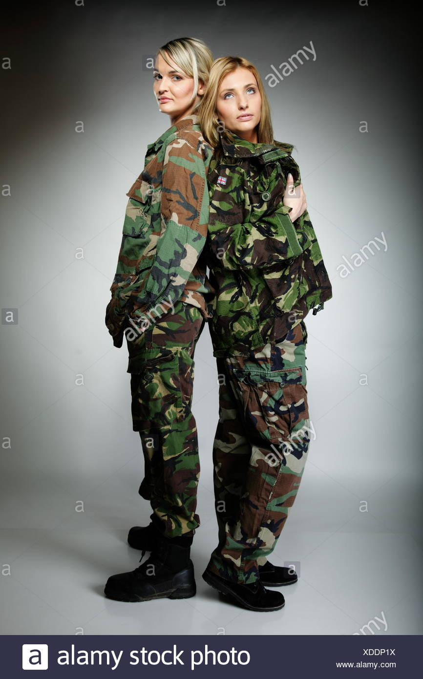 Full length two women in military clothes army girls on gray background. a8f150d554