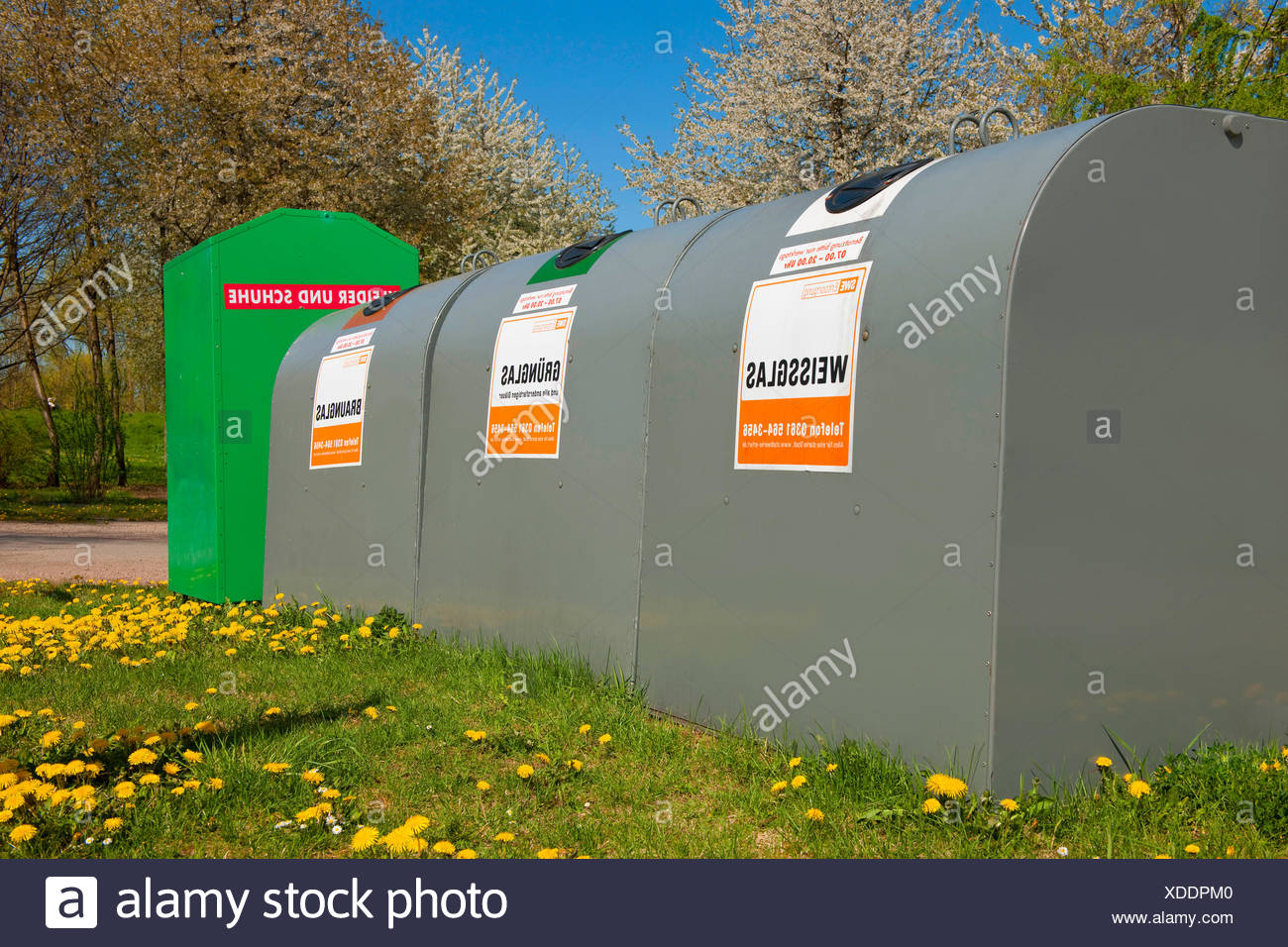 bottle banks and a charity bin, Germany - Stock Image