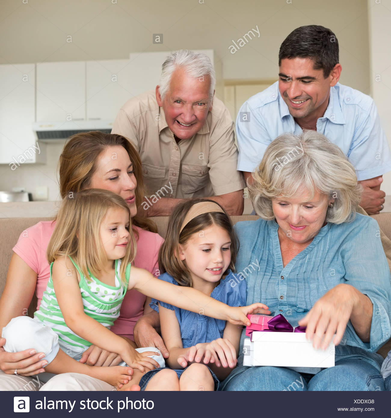 Family with gifts in sitting room - Stock Image