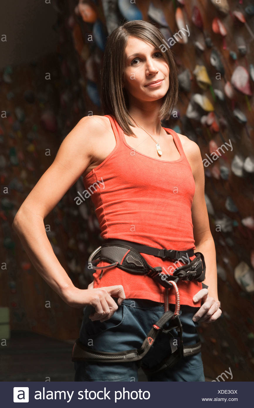 USA, Utah, Sandy, portrait of woman at indoor climbing wall - Stock Image