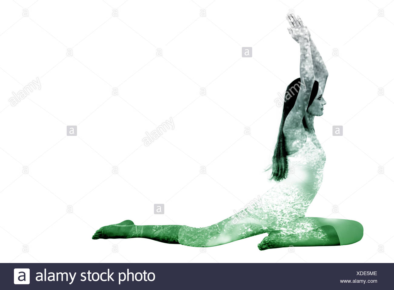 Composite image of sporty woman with joined hands over head at a fitness studio - Stock Image
