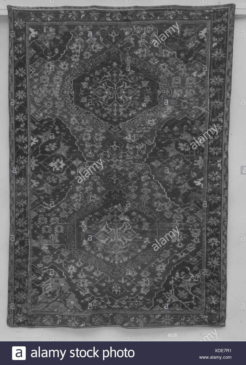 Carpet. Date: 18th century; Geography: Attributed to Turkey, Ushak; Medium: Wool (warp, weft, pile); symmetrically knotted pile; Dimensions: H. 118 - Stock Image