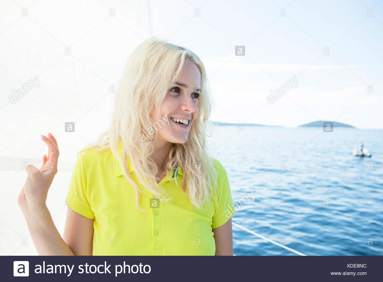 Portrait of woman on sailboat, Adriatic Sea - Stock Image