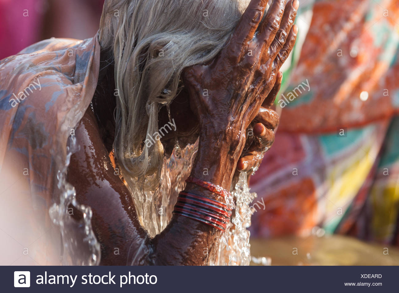 A pilgrim bathe on the most auspicious day of the Kumbh Mela. - Stock Image