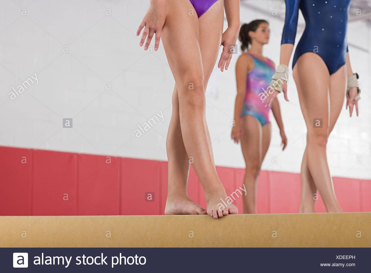 Gymnasts standing on a balance beam - Stock Image