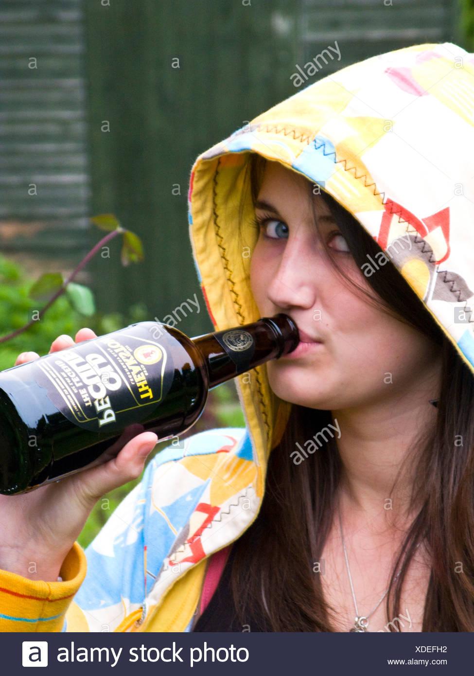 teenager drinking beer Stock Photo