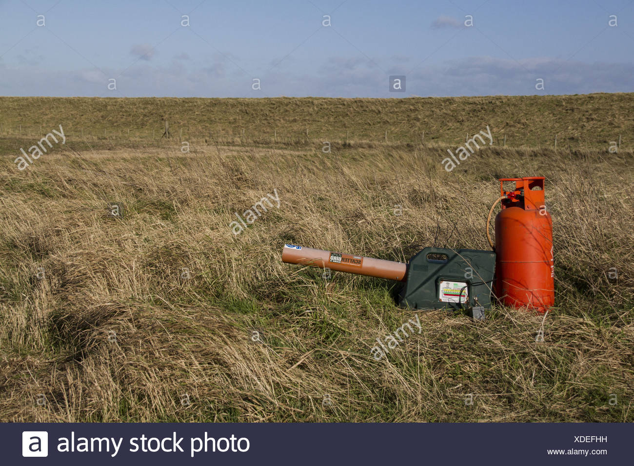 Gas-gun, gas powered bird scarer at edge of arable field, Norfolk, England, winter - Stock Image