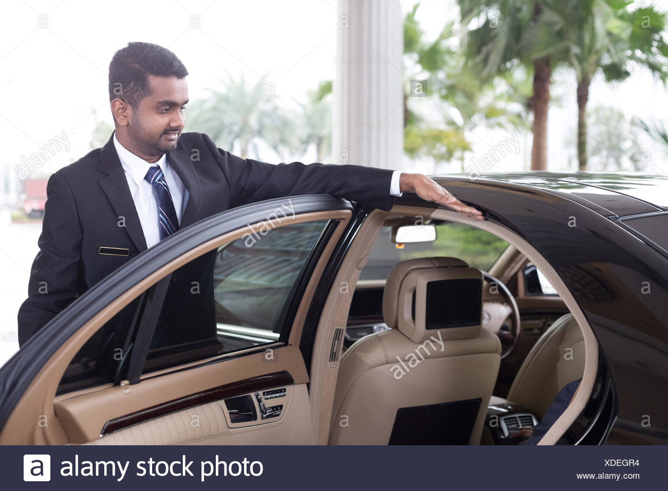 bellman servicing outside - Stock Image