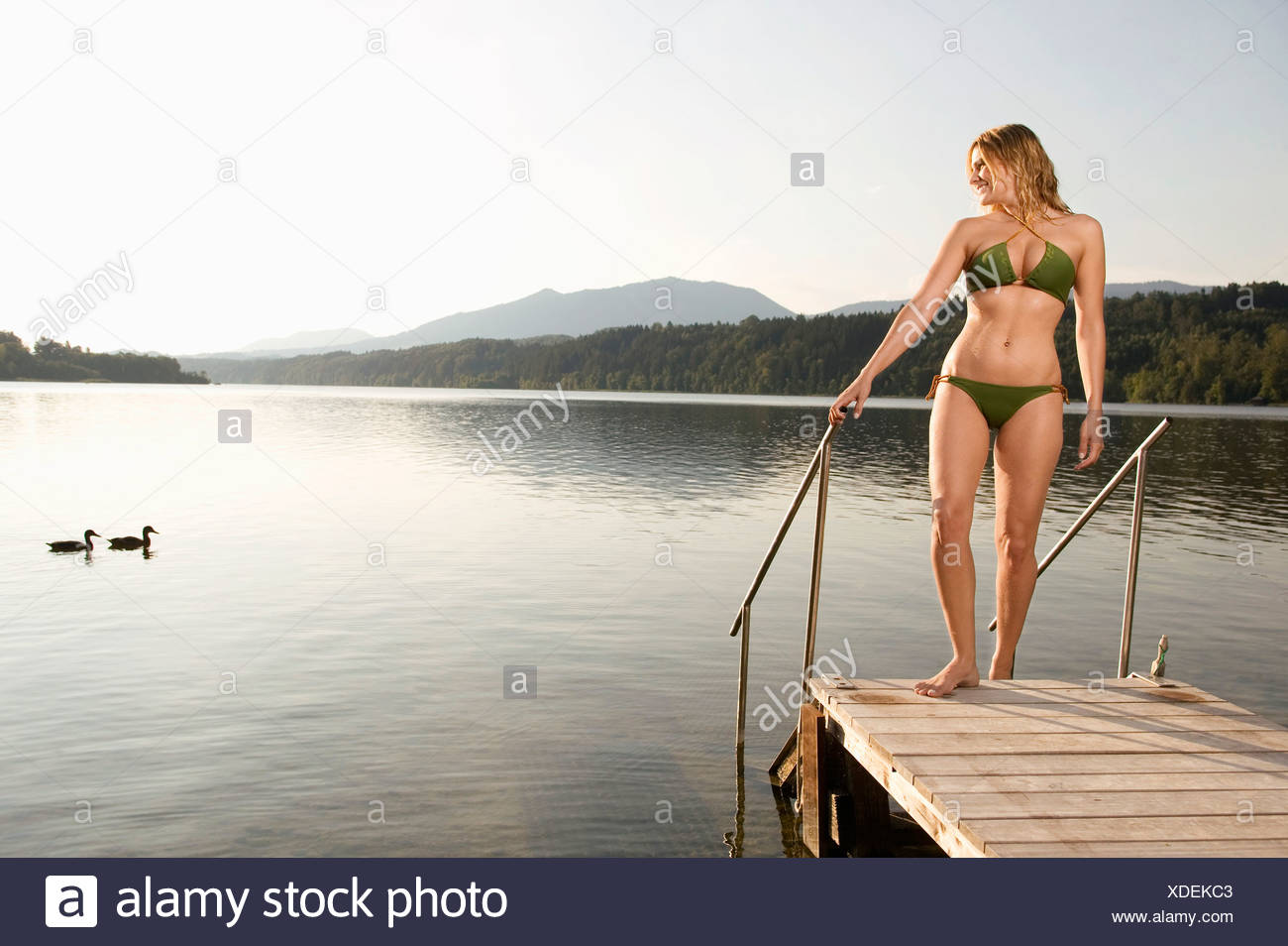 Woman standing on jetty - Stock Image