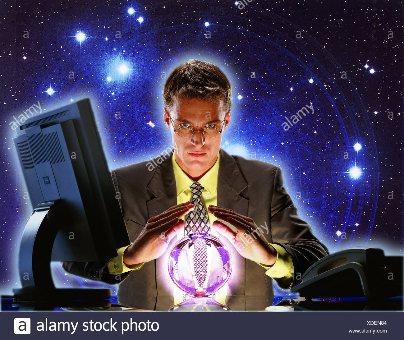 Composing, office, businessman, young, desk, crystal ball, swear, starry skystarry skystarry skies professions, man, glass ball, esotericism, spiritualism, clairvoyance, clairvoyant, foreteller, tell fortunes, invocation, mysticism, night heaven, concentr - Stock Image