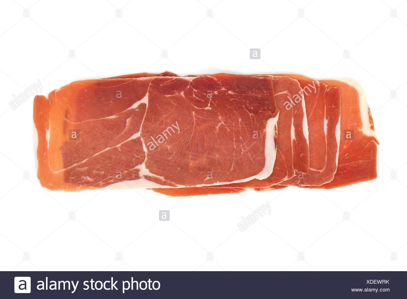closeup on a piece of spanish serrano ham - Stock Image