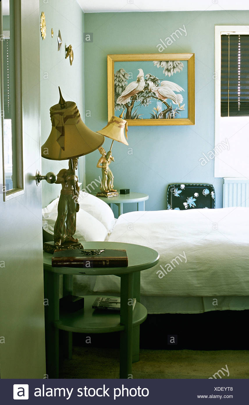 Gentil Unusual Figurine Lamps On Pale Blue Tables Beside Bed With ...
