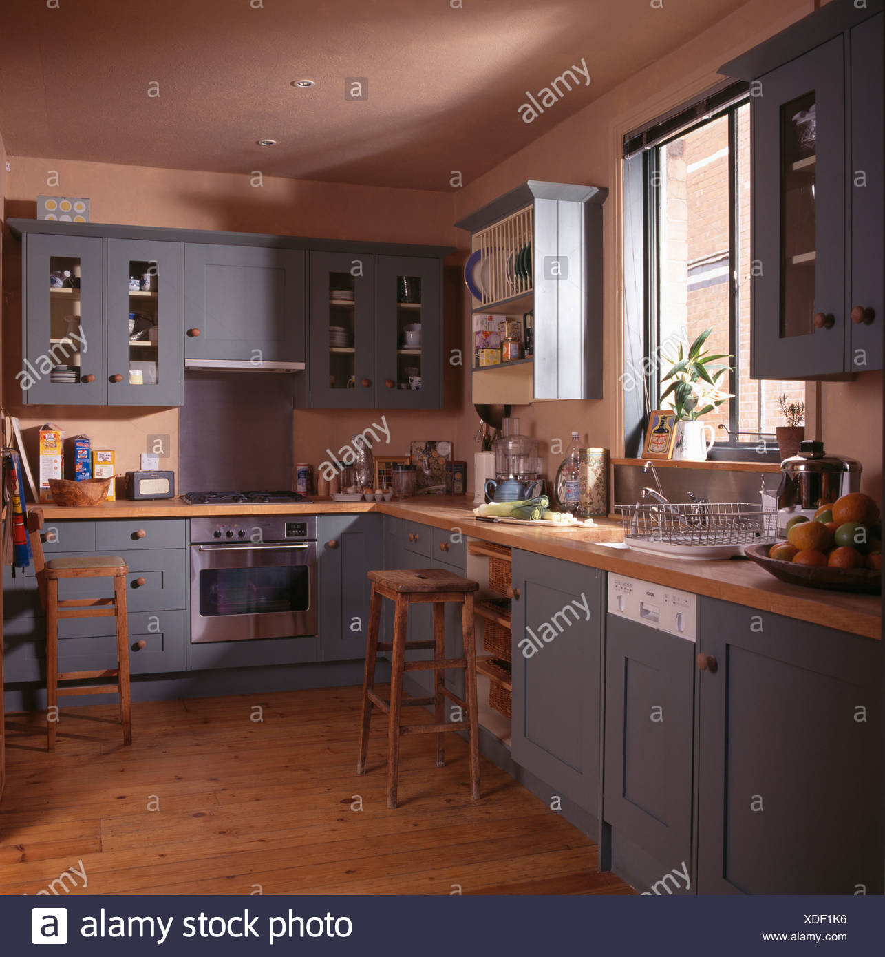 Blue Grey Fitted Units And Cupboards In Terracotta Country Kitchen