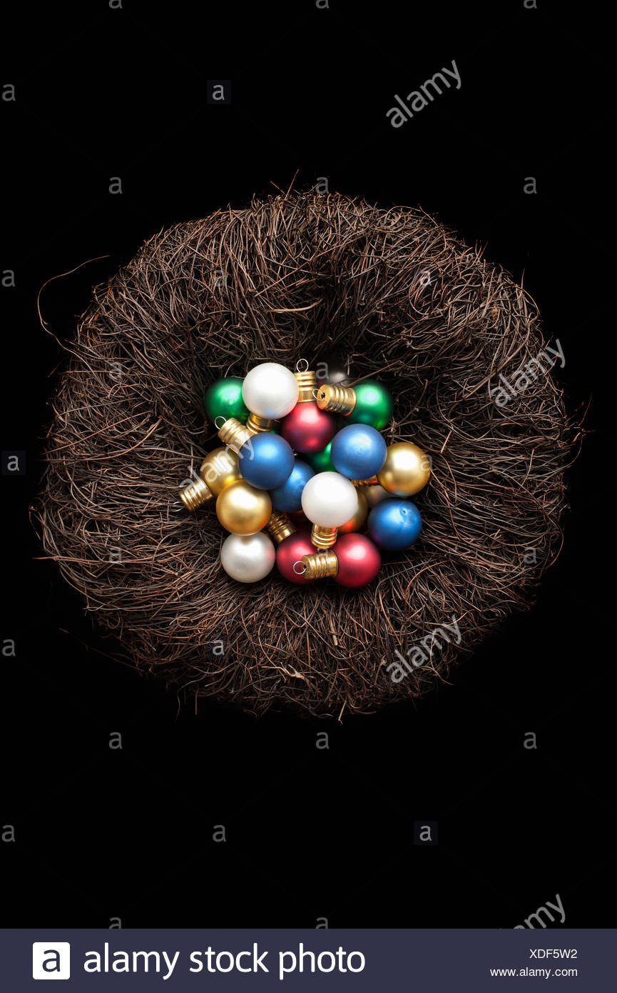 Christmas ornaments in birds nest - Stock Image