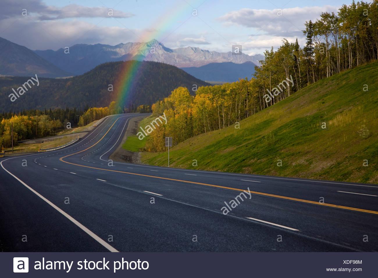 Rainbow over Glenn Highway in Matanuska Valley during Autumn in Alaska - Stock Image