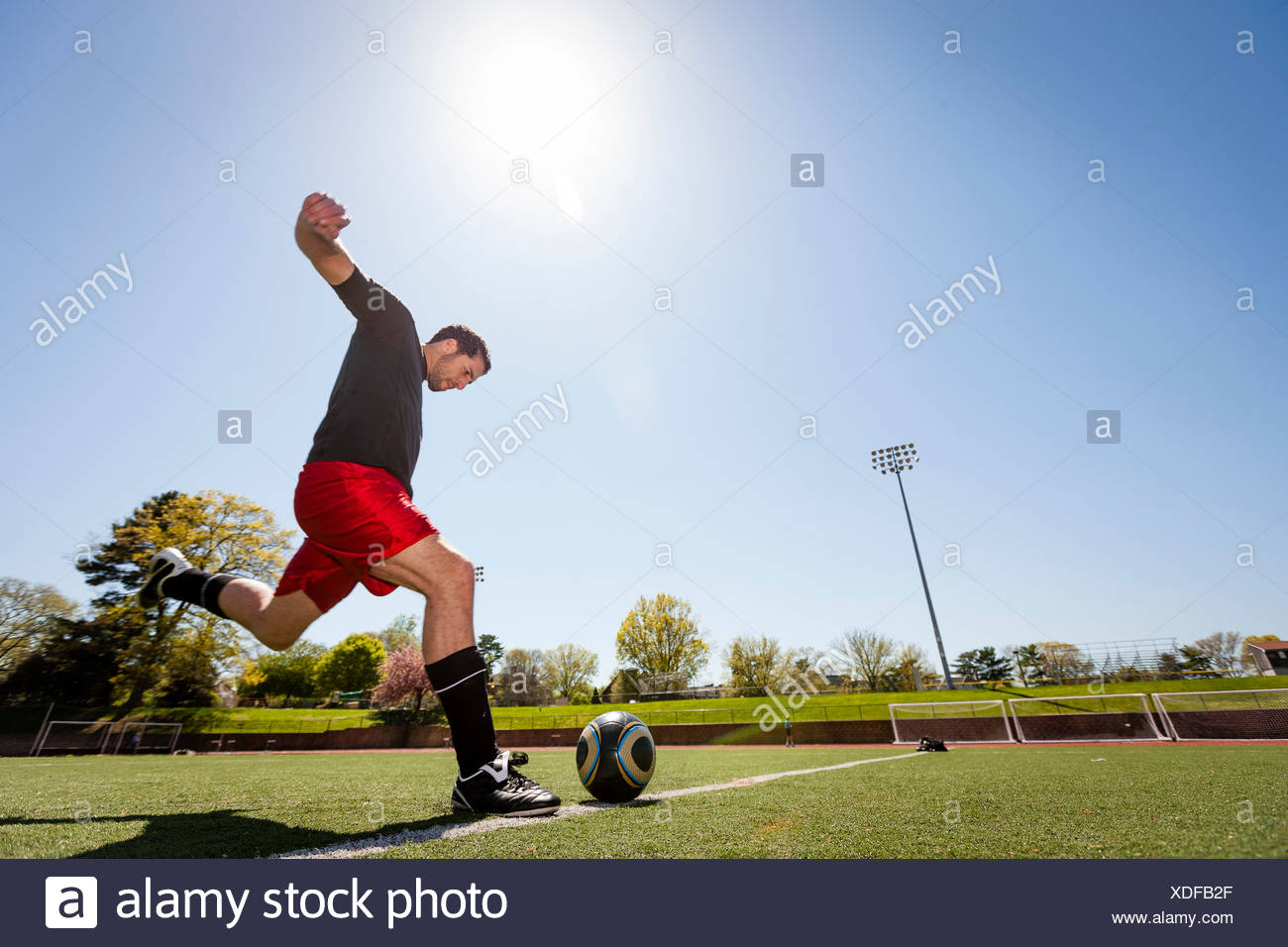 Soccer player taking free kick - Stock Image