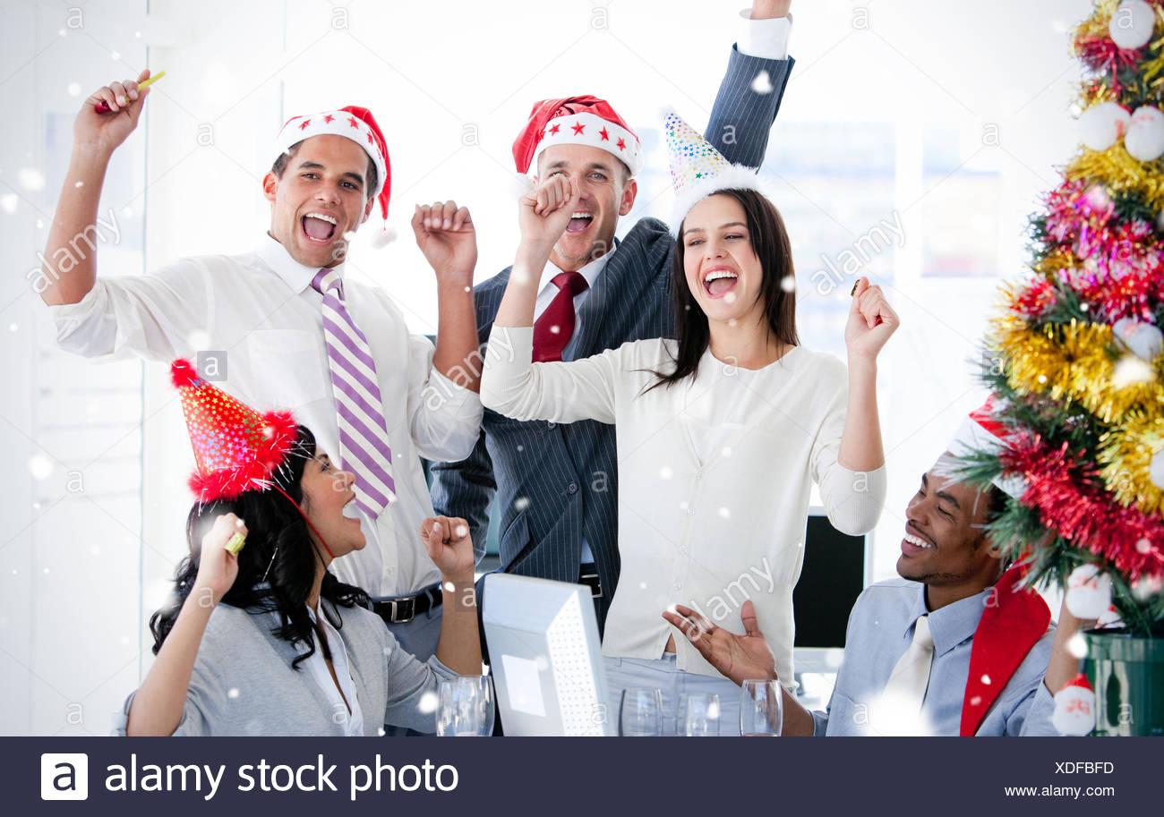 Business team punching the air to celebrate christmas - Stock Image